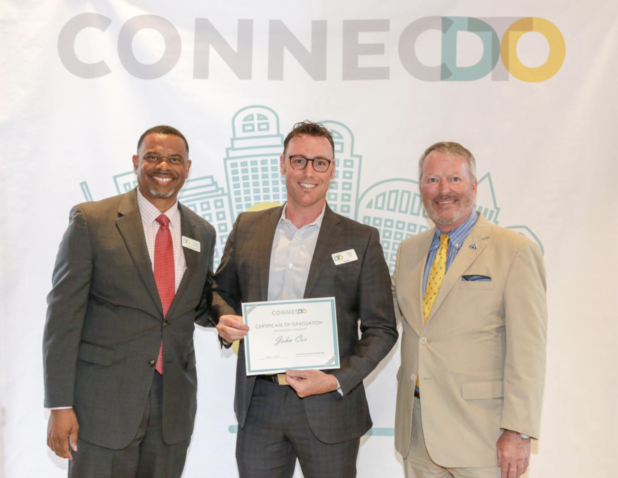 John receives his certificate of graduation with ConnectDTO...