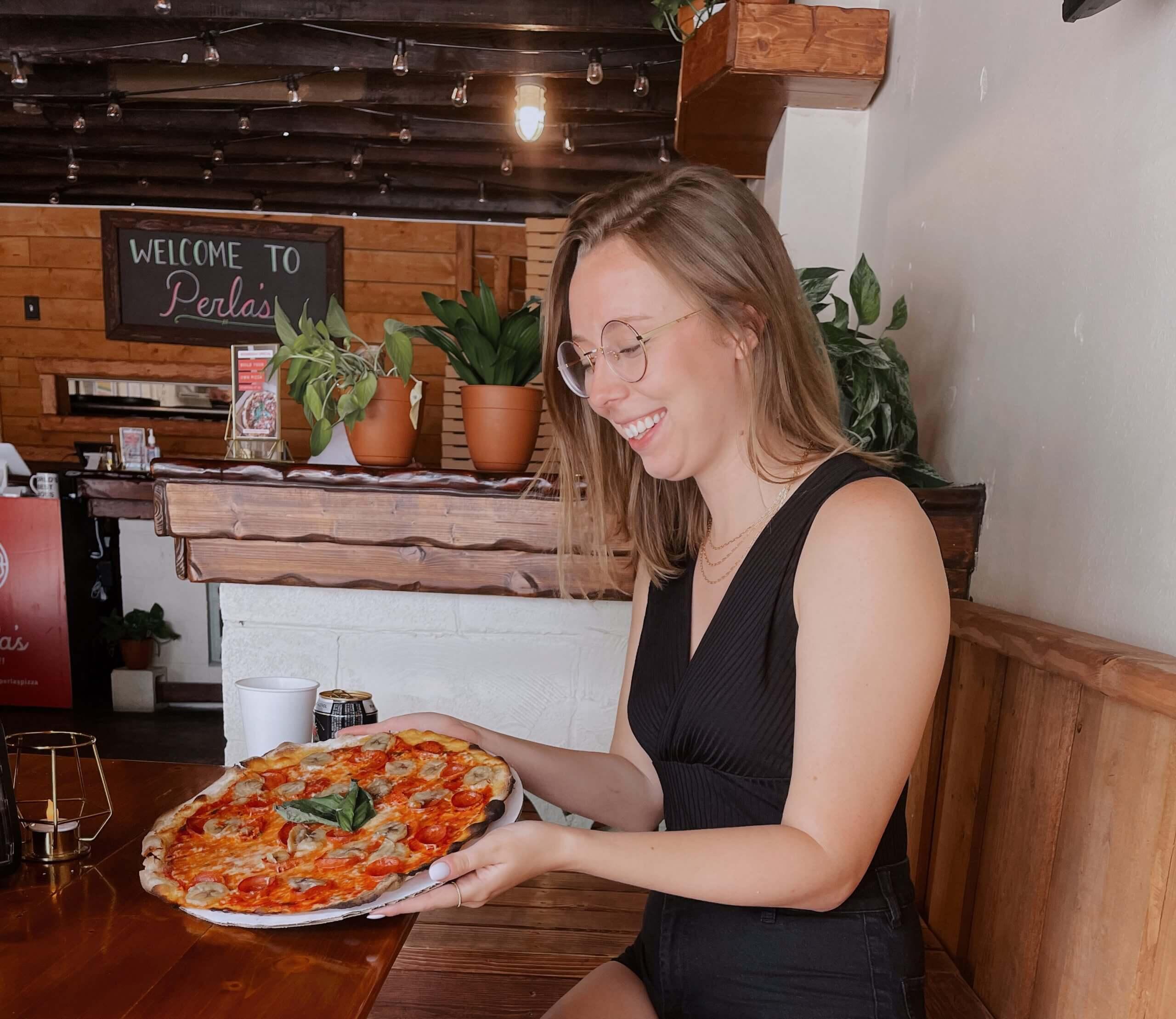 Jessie enjoying a pizza pie...